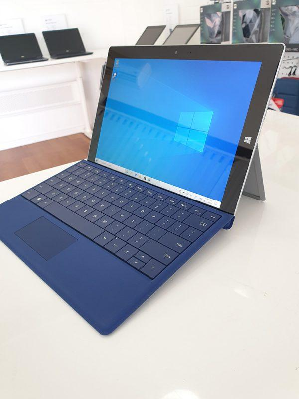 Refurbished Microsoft Surface 3 with blue keyboard side view