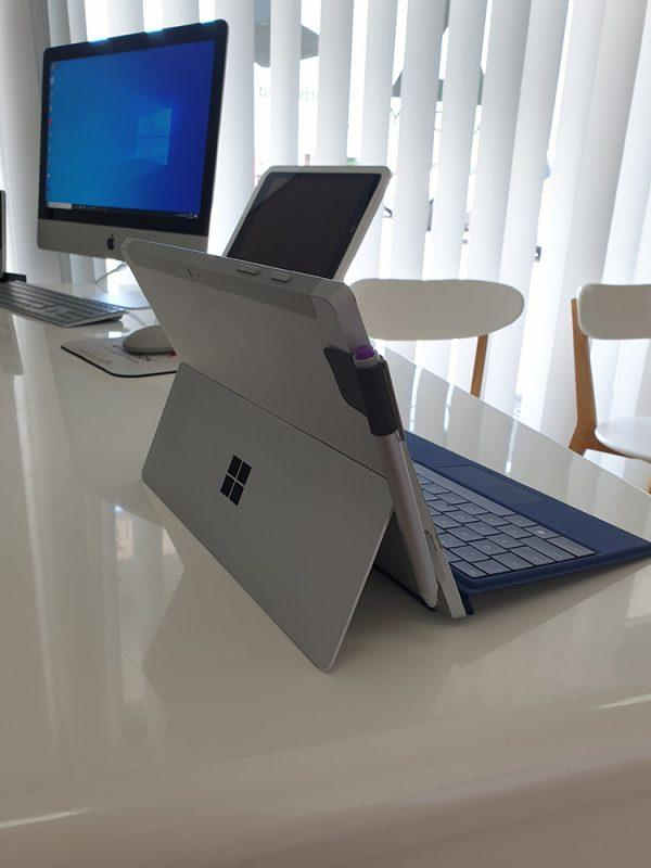 Refurbished Microsoft Surface 3 with blue keyboard back view