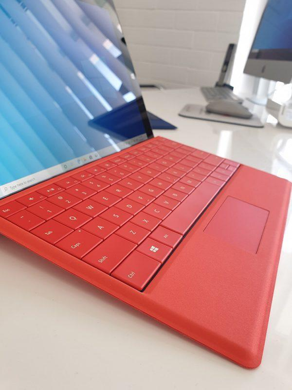Refurbished Microsoft Surface 3 with red keyboard