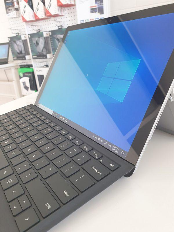 Refurbished Microsoft Surface Pro 4 with black keyboard side view